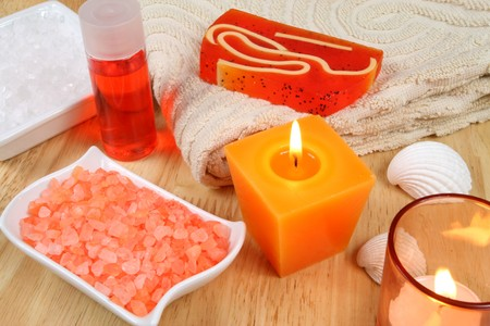 Spa therapy in energetic orange colors. Burning candles Stock Photo - 7150510