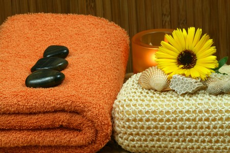 Beautiful natural composition of spa therapy objects, orange and yellow photo