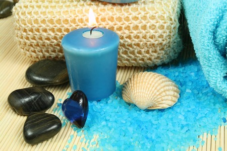 Spa soothe in blue color. Wellness therapy with pebbles and candle