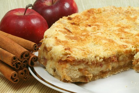 flaky: Fresh baked apple pie with red apples and whole cinnamon sticks. Delicious dessert