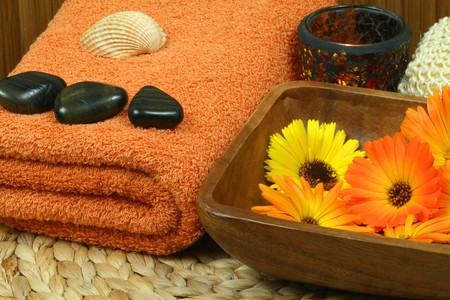 colorful orange wellness and spa therapy with beautiful marigold flowers. photo