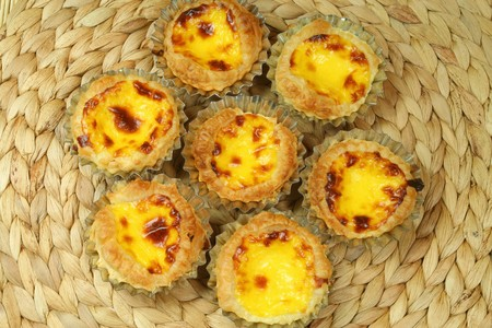 portugese: Traditional portugese  home made egg tarts - pastries pasteis de nata in tin molds