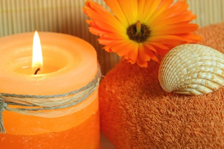 Beauty therapy in spa resort. Orange candle, marigold and shell Stock Photo - 7312579