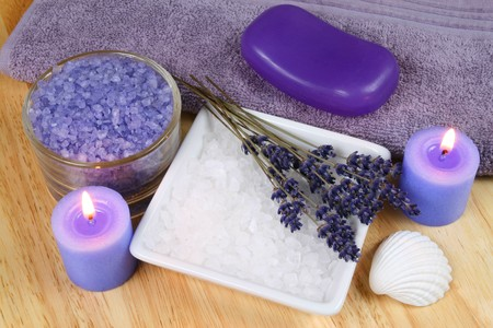 Spa resort therapy composition - dried lavender flowers, candles and salt crystals. Afternoon relax photo