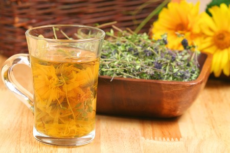 Glass of vaus infused herbs and bowl with dried thyme Stock Photo - 7312576