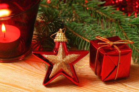 Closeup of Christmas ornaments in red color - glass glossy star and present. Beautiful holiday decoration photo