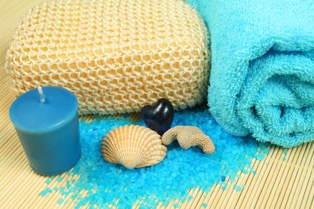 Spa soothe in blue color. Wellness therapy with sea salt, shell and candle photo