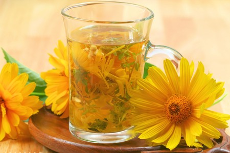 precipitate: Glass of fresh infused various aromatic herbs witch fresh yellow flowers