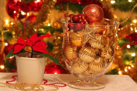 Beautiful Christmas decoration of table with shining of Christmas tree lights photo