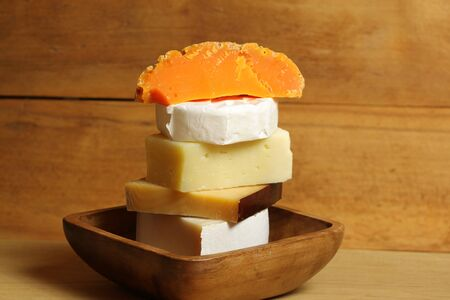 Five kinds of delicious cheese in wooden bowl. rustic scenery photo