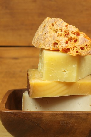 different kinds of cheese in pile. vertical photo photo