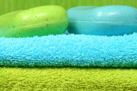 energizing: Green and blue towels and peeling soap bars. Energizing spa therapy Stock Photo