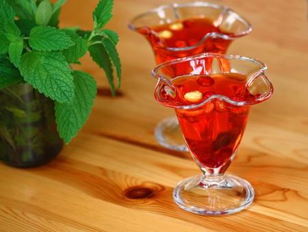 gelatin: Strawberry gelatin with wild strawberry fruits. Delicious dessert in glass cups Stock Photo