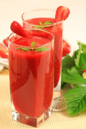 strawberry smoothie: Strawberry smoothies with fresh fruits and lemon balm leaves