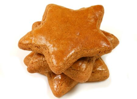 Gingerbread star shaped cookies stack isolated over white photo