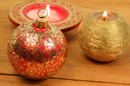 Christmas bauble and candles on wooden background photo