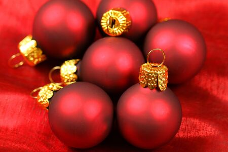 Macro of Glass Christmas baubles over silk red texture Stock Photo - 8379369