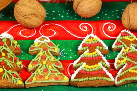 Christmas gingerbread cookie trees with artistic ornaments photo