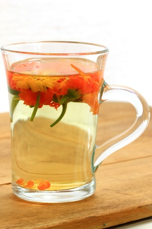 Healthy herbal tea with calendula flowers - natural therapy for flu photo