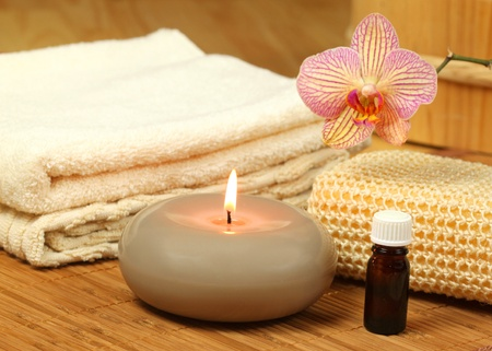 Spa treatment for beauty and relax. Candle, oil and orchid flower Stock Photo - 8379431
