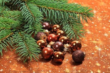 Decoration of Christmas table - group of small brown glass balls and conifer branch photo