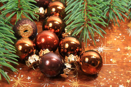 Christmas small baubles and fresh aromatic conifer branch photo