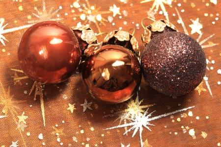 Three brown shiny Christmas glass balls photo