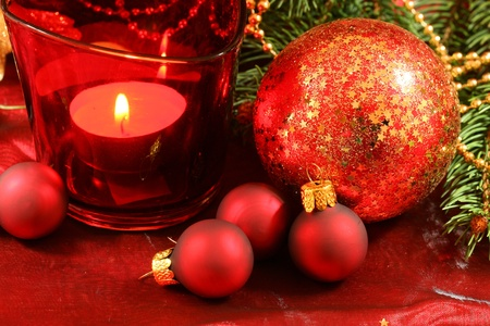 Red Christmas decoration with glass balls, fir branch and candle Stock Photo - 8418178