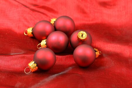 Christmas red glass balls over red silk background Stock Photo - 8418168