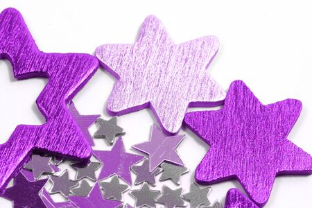 Christmas stars background - purple and silver ornaments over white photo