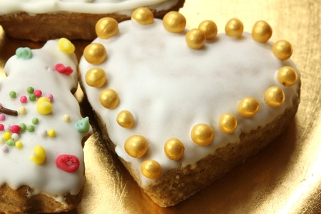 Beutiful gingerbread heart with golden sugar pearls photo
