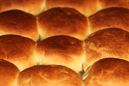 french bread rolls: Buns baking in oven. Food background Stock Photo