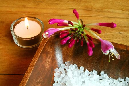 Spa still life. Honeysuckle flower, candle and seasalt photo