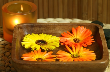 Spa treatment for beauty and relax. Candle and calendula flowers photo