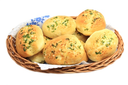 Home-made buns with garlic, parsley ans salt spice in basket isolated photo