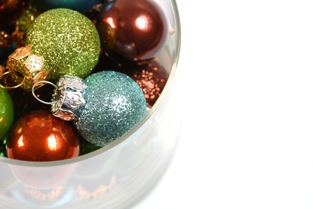 Closeup of Christmas balls in glass photo
