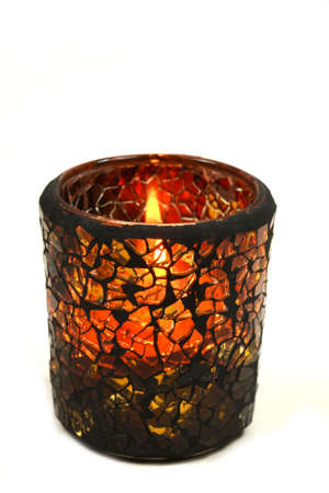 candle holders: Autumnal candle isolated over white Stock Photo