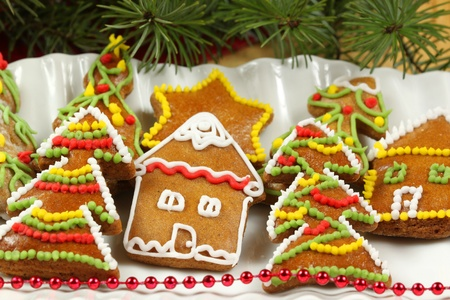 Decorative gingerbread Christmas cookies on plate photo