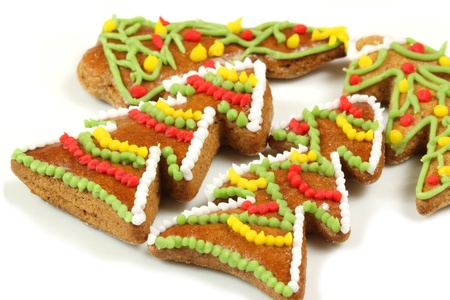 Christmas gingerbread trees with beautiful colorful icing decoration photo