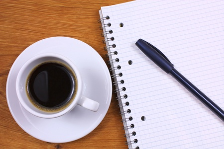 pens: Coffee and writing pad. Looking for inspiration Stock Photo