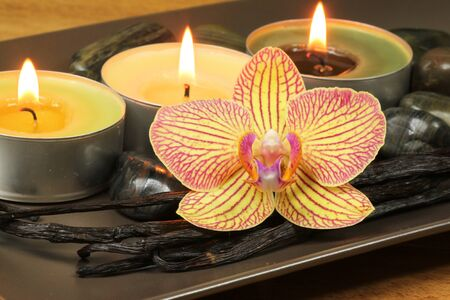 Spa aromatic composition with orchid and candles photo