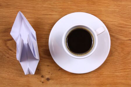 Coffee cup of espresso and origami paper dove. Inspiration photo