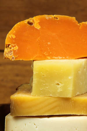 Closeup of various kinds of hard cheese photo