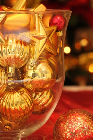Christmas golden and red ornaments - table decoration photo
