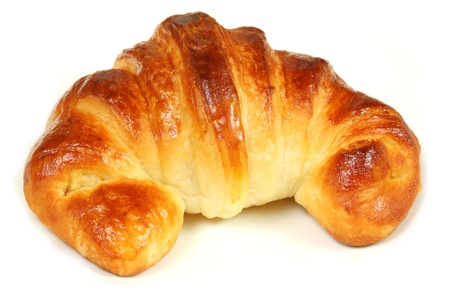 Home made croissant isolated on white background photo