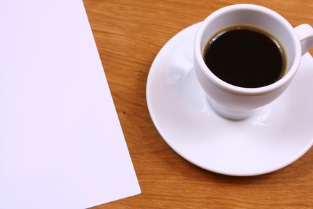 Black coffee and paper on desk photo