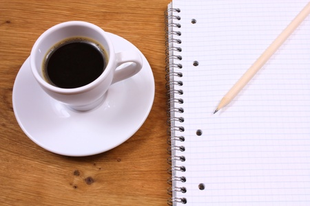 Coffee and writing pad. Looking for inspiration photo