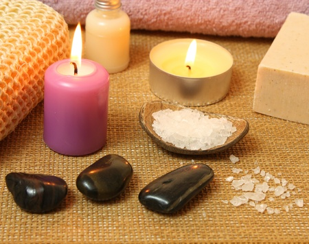 Spa therapy composition with candles and massage stones photo