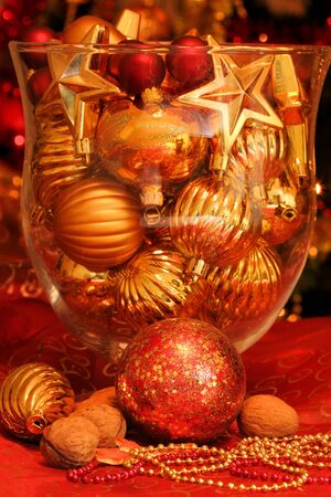 Christmas ornaments in glass vase. Table decoration photo