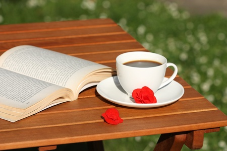 coffee table book: Coffee and book in the garden